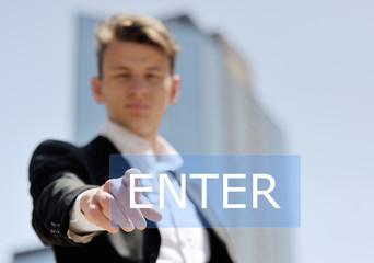 man pushing virtual enter button, technology concept