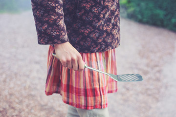 Young woman holding a spatula