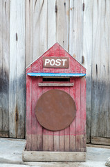 Postbox in front of retro wooden door
