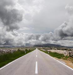 open road and stormy clouds