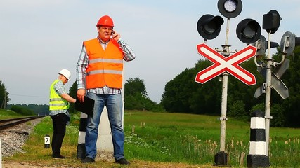 Railroad workers with folders near signal beacons episode 2