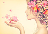 Fototapety Girl takes beautiful flowers in her hands. Blowing flower