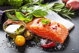 Fototapety Delicious  portion of  fresh salmon fillet  with aromatic herbs,