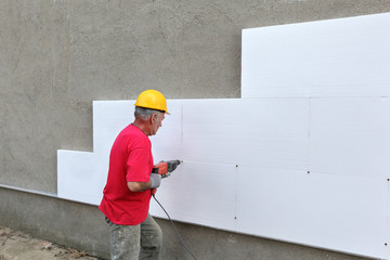 Construction site, styrofoam insulation drilling for anchor