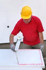 Construction site, polystyrene insulation glue applying