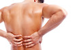 Rear view of a muscular man holding his back in pain, isolated o