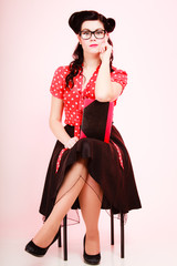 Retro. Pinup girl in eyeglasses with book