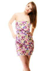 Summer fashion. Teenage girl in floral dress isolated
