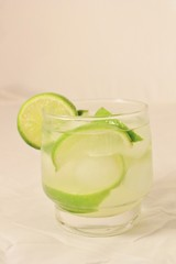 Caipirinha cocktail with limes