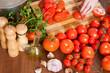 Closeup of  hands  slicing tomatoes