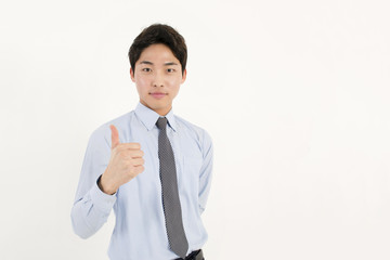 Success businessman thumb up