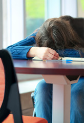Young college or high school student asleep on table