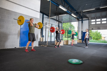 Workout team training at crossfit center