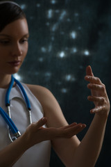 Female doctor holding something hands