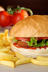 Big vegetarian burger with lettuce, tomato and French fries