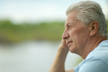 elderly man on summer background