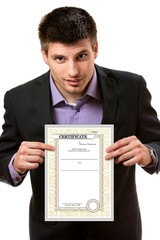 Smiling young business man,showing a certificate