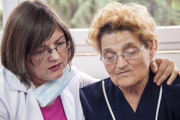 Woman doctor and senior patient