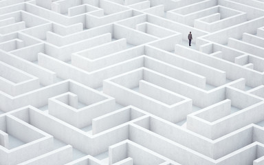 Businessman looking for way out of a maze