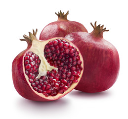Two whole and one half of pomegranate isolated on white backgrou
