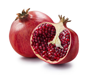 Whole and half of pomegranate isolated on white background