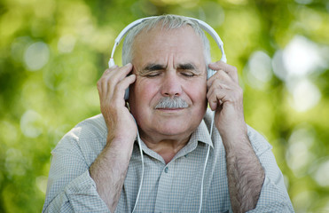 Pensioner enjoying his music