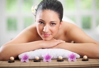 young beautiful woman relaxing in spa center