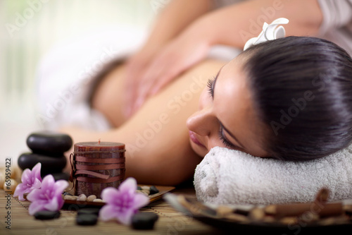 Beautiful woman having a wellness back massage Plakát