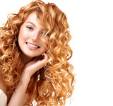 Fototapety Teenage model girl portrait isolated on white. Red curly hair