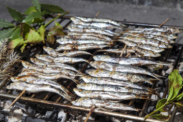 Fresh sardines, mackerel fishes on BBQ grill