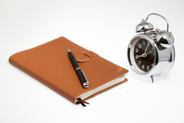 notebook with clock