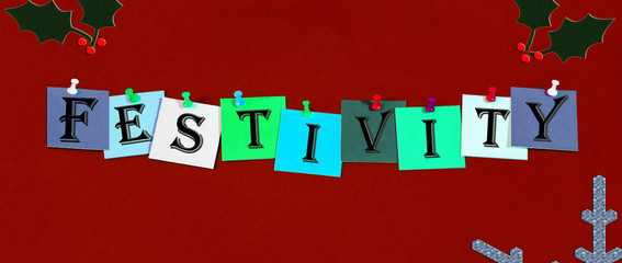 Fesitivity, sign in words with holly & snowflake for Christmas.