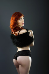 Rear view of a woman in lingerie looking over her shoulder