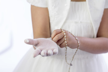 Young girl dressing for her First Communion