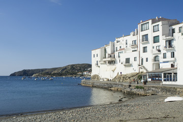 White houses near the beach and the sea, in a coastal landscape,