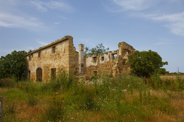 Ruins of old farmhouse in countryside