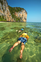 two asian human diving in thailand