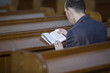 Man reading the Bible in church
