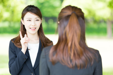 asian businesswomen on green background