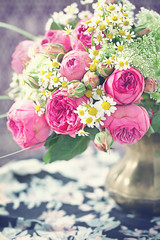 beautiful bouquet of a fresh flowers roses and daisies