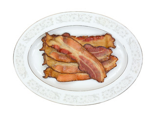 Cooked smoked bacon slices on platter