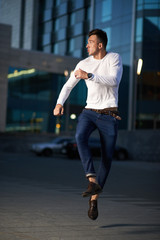 trendy handsome guy jumping late for