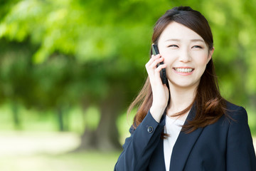 asian businesswoman using smart phone