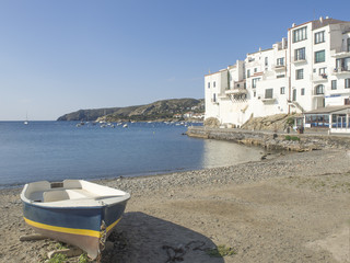Boat  and whites houses on the beach, coastal landscape