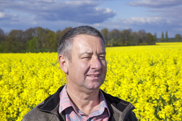 Farmer controls his canola field