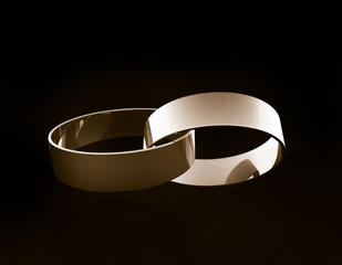 Gold wedding rings linked together