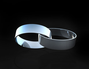 White gold or platinum wedding rings linked together