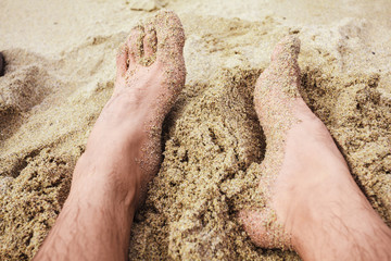 The feet of a man on the beach
