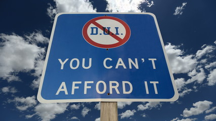 DUI You Can't Afford It Warning Sign with Time Lapse Clouds