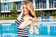 Beautiful girl posing near the swimming pool